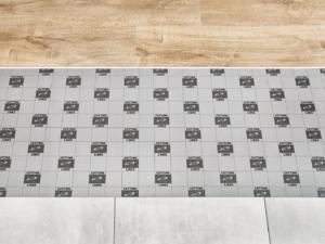 Installation of vinyl panels on old tiles